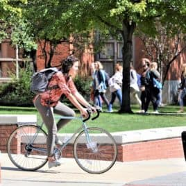 college student riding a bike