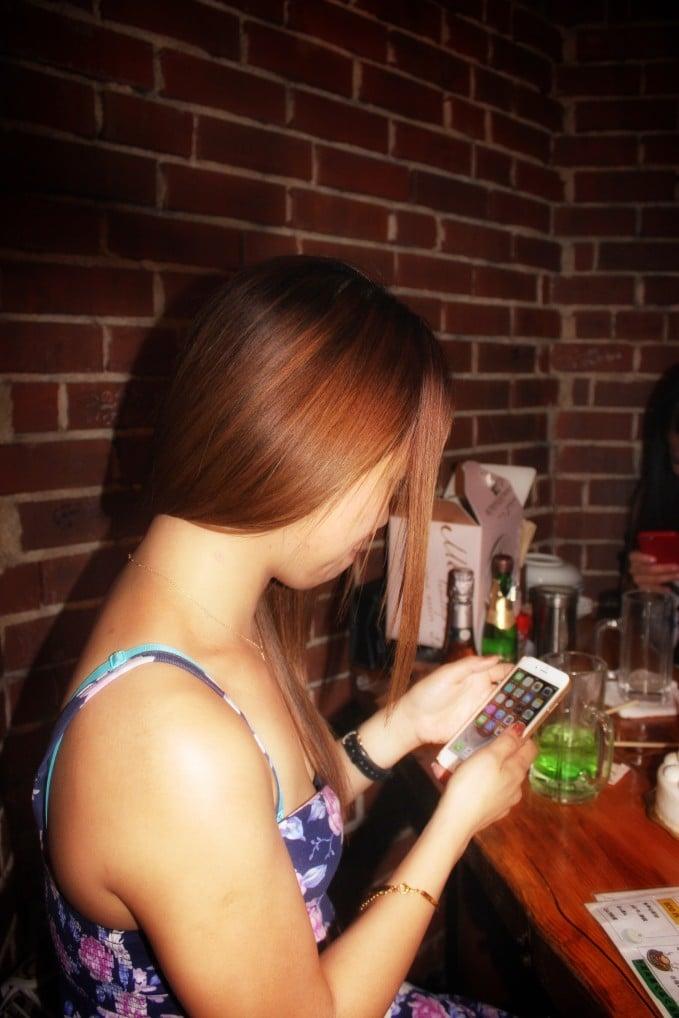 girl at bar drinking