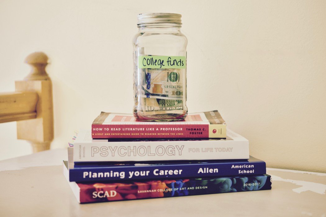 text books and savings jar