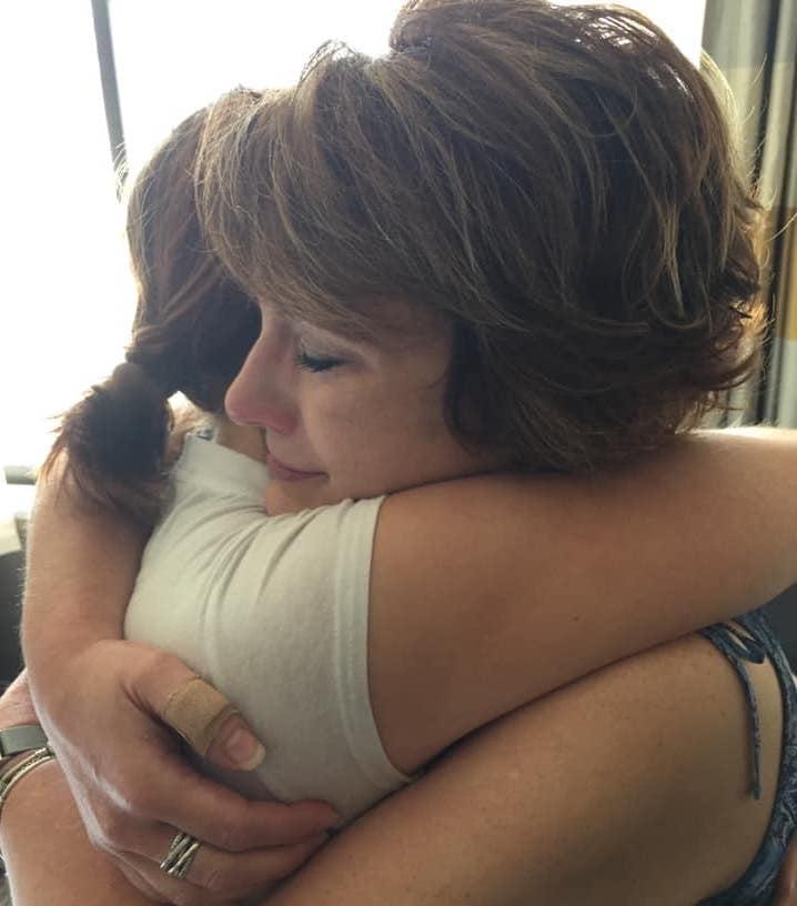 mom daughter hug