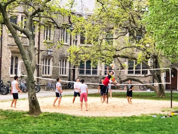 college students plying volleyball