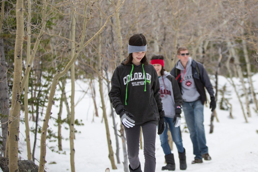 family walking snow