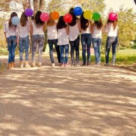 teen girls holding balloons