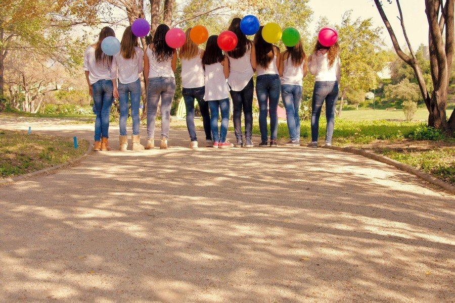 teen girls holding balloons