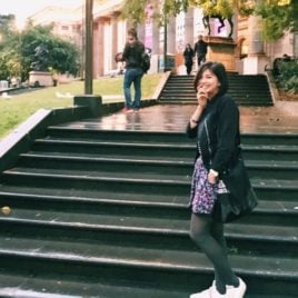 girl standing on college steps