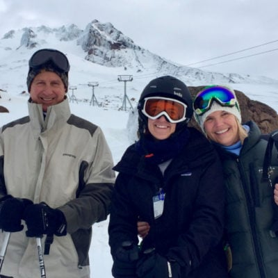 family skiing together