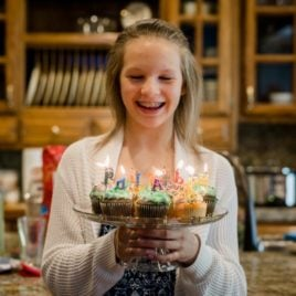 teen girl with birthday cupcakes