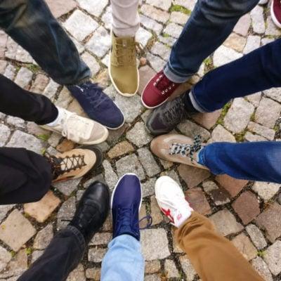 teens putting feet in a circle