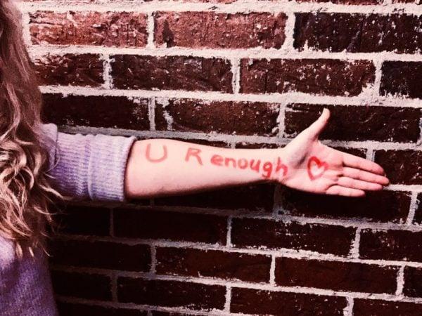 self love statement written on arm