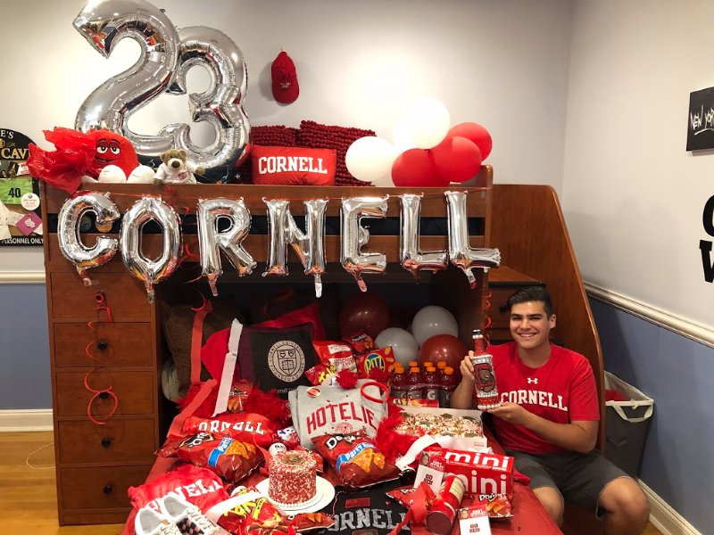 bed decorated in Cornell colors