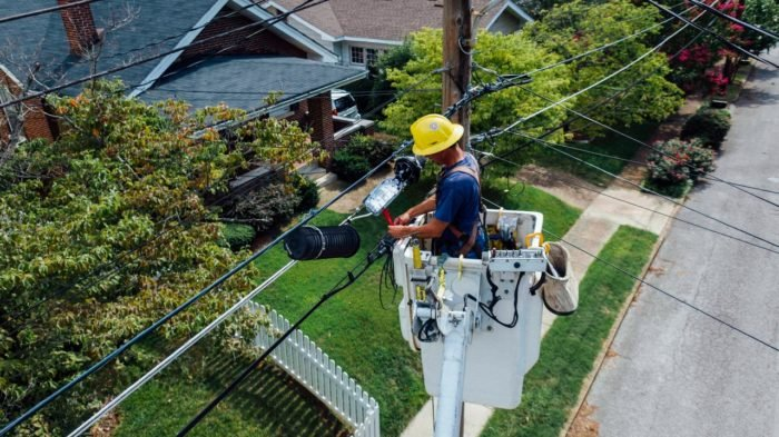 man working on telephone lines