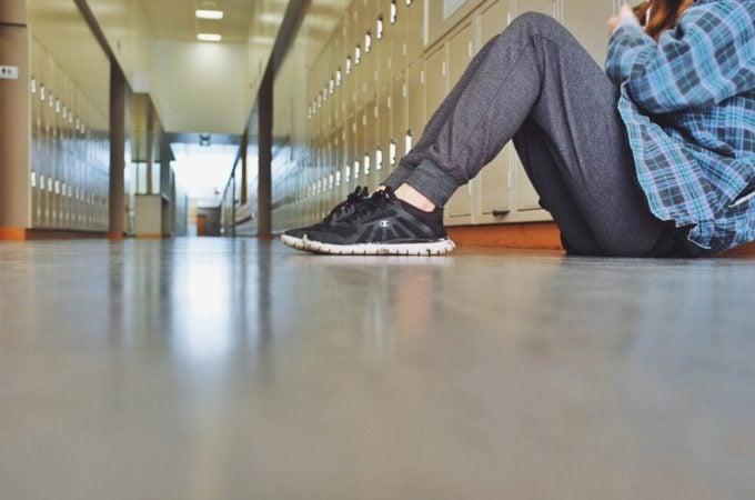 teen girl in school hallway