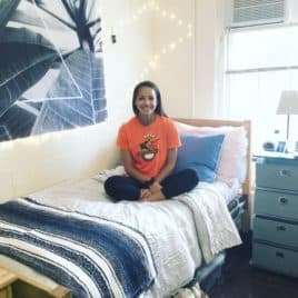 college student on her dorm bed