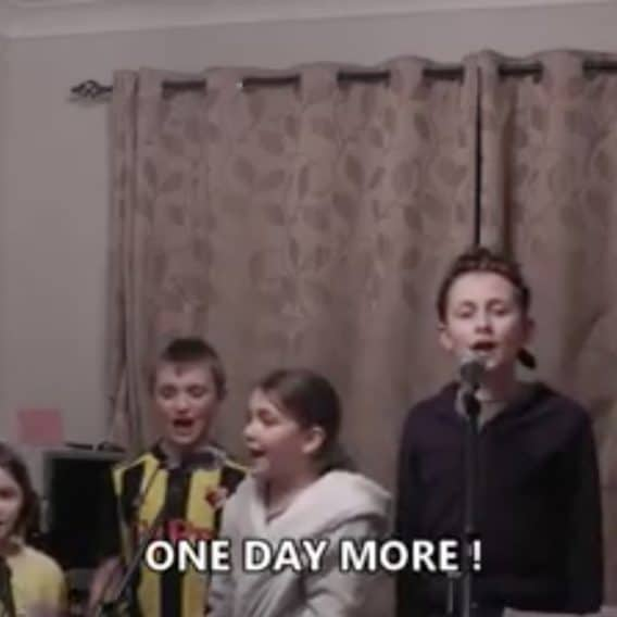 family singing Les Mis