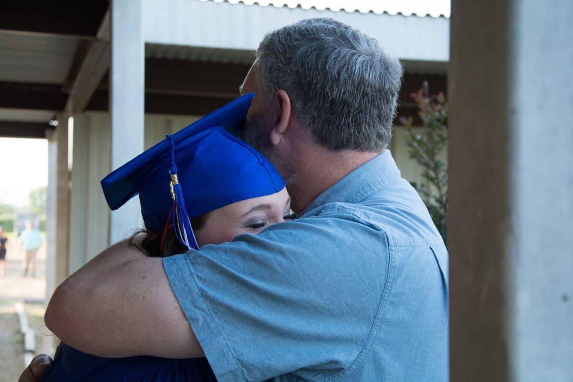 dad hugging grad