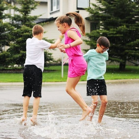 tweens jumping in puddles