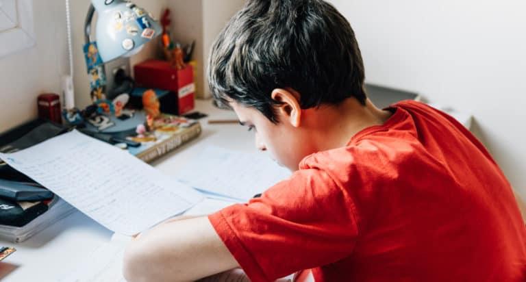teen boy at desk