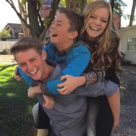 three teens laughing