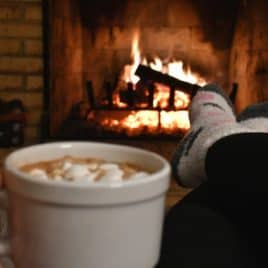 drinking hot chocolate by fire