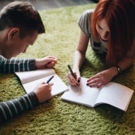 boy and girl doing homework together