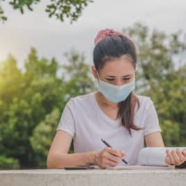 Girl studying with mask