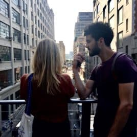 couple arguing on bridge in NYC