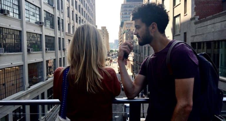 couple arguing on bridge in NYC