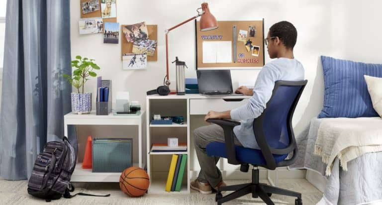 teen boy at desk in room
