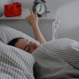 teen sleeping in bed